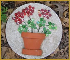 """Garden Mosaic Stone. If you broke the flower pot into pieces, you could create a mosaic """"pot"""" and actually step on this."""