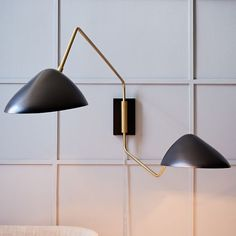 Curvilinear Mid-Century Sconce - Double | west elm I can't believe these are from West Elm! And I still want them