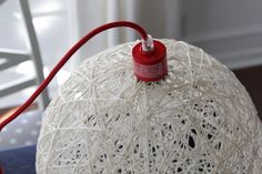 DIY Yarn Ball Light Fixture.