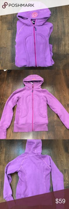 Lululemon Scuba Hoodie Lululemon scuba hoodie. Excellent condition only worn a few times. Purple with neon pink logo on hood and different color purple zipper. Size 2. lululemon athletica Tops Sweatshirts & Hoodies