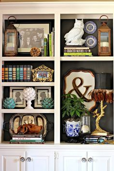 Hanging pictures/items on the back wall of bookcase.  I could do this in our lawyer's shelves.