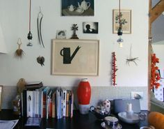 graphic black and white print + a collection of objects = perfectly curated wall