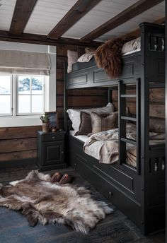 Rustic styled guest bedroom with black bunk beds. Hewn walls and fur pelts. Black Bunk Beds, Bunk Beds With Stairs, Loft Stairs, Cozy Cabin, Cozy House, Cabin Homes, Log Homes, Black Bedding, Bedroom Black