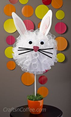 Try cutting styrofoam ball in half and perhaps using a larger one for door/wall decor.  Cute! DIY Deco Mesh, Bunny Pouf Topiary on CraftsnCoffee.com.