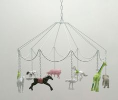 make this with crystals insted of plastic animals decorate as shabby chick. cute DIY idea: Carousel Mobile with plastic animals Diy And Crafts, Crafts For Kids, Party Set, Deco Kids, Plastic Animals, Plastic Animal Crafts, Plastic Dinosaurs, Felt Animals, Idee Diy