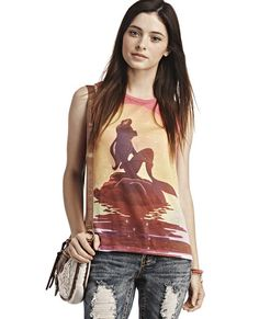 """<p>Gorgeous and colorful, this muscle tank top shows Ariel's™ (from Disney's """"The Little Mermaid™"""") silhouette against the sunset as she sits on a rock above the water on the sheer knit front, while the contrasting sheer chiffon back shows her and Prince Eric™ about to kiss. Tank has a round neckline, rounded slightly longer hem at the back and is unlined.</p>  <p>Model is 5'9"""" and wears size small.</p>  <ul> <li>100% ..."""