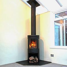 Contura 510 wood stove with slate hearth and Poujalait stainless steel insulated chimney system, Fitted in Eastwood Essex 2011 Slate Hearth, Fire Surround, Log Burner, Fireplace Design, Interior Design Inspiration, Cabana, Bespoke, Tiny House, New Homes