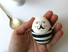 Circus Easter Egg. DIY holiday arts & crafts & activities for kids. Painted mustache man with black and white stripes.  Circus inspired decoration.