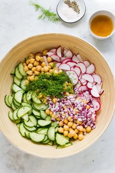Radish and Cucumber Salad features peppery radishes cooling cucumbers and fresh dill tossed with protein rich chickpeas and apple cider vinaigrette. Minimal ingredients and ready in under 15 minutes! Cucumber Recipes, Cucumber Salad, Healthy Salad Recipes, Whole Food Recipes, Healthy Snacks, Vegetarian Recipes, Healthy Eating, Cooking Recipes, Fast Recipes