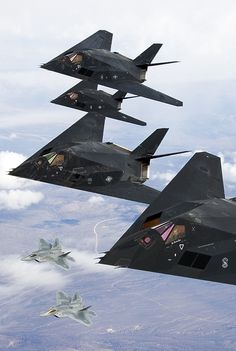 F-117 Nighthawk Stealth Flight with F-22 Raptors in flight formation.