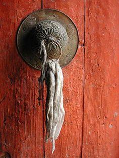 nepal. orange door.