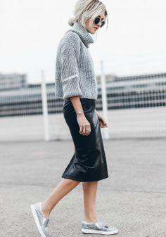 Jacqueline Mikuta + contemporary style + chunky cropped sweater + leather midi skirt + sequined sneakers + Delicate metallic details + contrasting textures + street-ready look.  Sweater And Skirt Outfits:  Sweater and Skirt: Verge Girl, Shoes: Sam Edelman, Sunglasses: ZeroUV