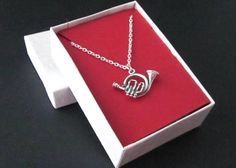 This French horn necklace is a lovely graduation or birthday gift for the student who participates in high school or college band, or anyone who