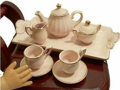 Princess Pink Miniature Fine China Tea Set Perfectly Sized for American Girl Dolls by The Queen's Treasures. $29.99. Fine china porcelain tea set scaled perfectly for use with collectible Dolls or tea set collections. Nothing could be prettier than this fine quality miniature porcelain tea set scaled just right for use with collectible dolls or tea set collections. Designed and exclusively manufactured by The Queen's Treasures. All are attractively stored in a b...