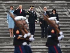 First Lady of the US Melania Trump, President Donald Trump, US Army Maj. General Bradley Becker, Vice President Mike Pence and Karen Pence look on at the start of the inaugural parade