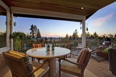 A romantic outdoor seating area with incredible mountain and water views. This space could also be ideal for outdoor entertaining. Yarrow Point, WA Coldwell Banker BAIN $3,498,000