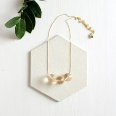 Peach Lucite Necklace handmade by Owlkill Studio