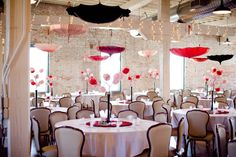 Fun reception decor with poppy red accents