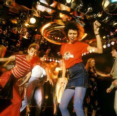A group of people get down on a mirrored dance floor, circa 1978.