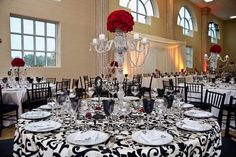 Black and white damask with red and silver accents...very similar to how my reception will look!!!