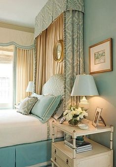 Adding drapes behind the bed, gives the illusion of more windows in the room and another way to add color.