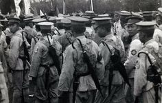 Chinese troops equipped with umbrellas, pre-WW2.