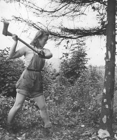 Hardcore! A member of the Women's Land Army felling a young tree with an axe, 1941. A younger version of Penny in the book.