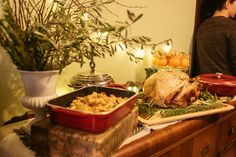 A Febgiving spread, including sausage stuffing in Nordic Ware open baker, a roast turkey, and sweet-potato stuffed oranges with rosemary orange shortbreads. Sarah McGee / Heavy Table