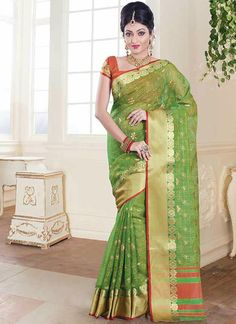 Include yourself in to the glamour of a season with this elegant green tussar silk casual saree. This beautiful attire is showing some extraordinary embroidery done with lace work. Comes with matching...