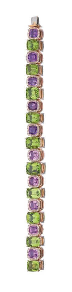 PERIDOT, PINK SAPPHIRE AND DIAMOND BRACELET, MICHELE DELLA VALLE.   Designed as a line of alternating cushion-shaped peridots and pink sapphires, the pink sapphires framed by a border of brilliant-cut diamonds, length approximately 180mm, signed MdV, pouch stamped Michele della Valle