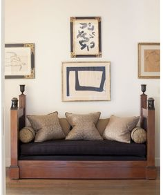 Interesting combo of Asian artwork, daybed that looks like a chaise for Cleopatra, black cushion against subtly textured pillow fabrics.