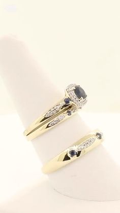 Matching yellow gold wedding rings, featuring a diamond halo and blue sapphire engagement ring! Wedding Rings Sets His And Hers, Matching Wedding Rings, Wedding Rings Simple, Classic Engagement Rings, Sapphire Wedding Rings, Diamond Wedding Rings, Wedding Ring Bands, Minimalist Wedding Rings, Gold Ring Designs