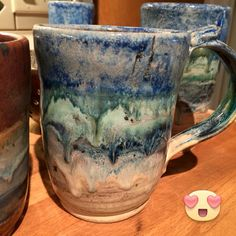 Toasted Sage base coat (2 coats) for top 3/4 of mug. Top band Indigo Float (2), middle band Dark Green (2), third band Midnight Blue (2).  Bottom 1/4 of mug is Oatmeal (3coats).  Laguna 50/50, Cone 04 Bisque, Cone 5 glaze, Fast Speed with  8 min hold.