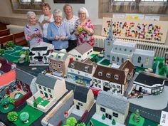 Knit and crochet replica of town high street created by yarn artists of Thrapston, Northants, complete with hanging baskets and pedestrians (fixed the headline for you) Knitting Humor, Hanging Baskets, Norfolk, Knit Crochet, Nostalgia, Culture, Artists, Street, Fall Hanging Baskets