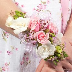 Sachet Corsage ~ created with sweetheart roses and freesia. These sweet-scented pink, white, and lavender flowers make the memory of your special day linger. #prom #homecoming #party