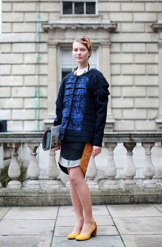 60 Inspiring Street-Style Snaps From LFW #refinery29  http://www.refinery29.com/london-fashion-week/street-style#slide-16  Love how the feathers of her headpiece match the colour of her skirt.