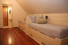 Patterned pillow, neutral bedding & horizontal paneling
