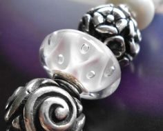 What a gorgeous unique Trollbead ...white with a touch of pink!