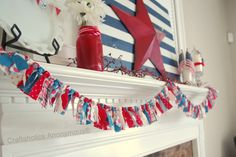 Red, White, and blue knotted fabric banner. so easy! Great scrap buster craft too.