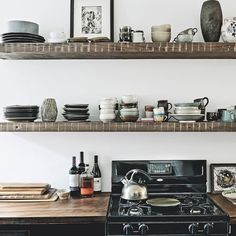 Rustic open shelves to store pottery
