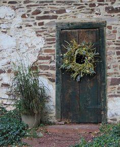 cool spring wreath on rustic door