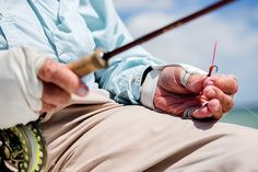 Expert angler/fly fishing legend Lefty Krehsits at the ready, bonefish fly in hand, during a day on the flats. Photo by Andy Anderson. | Garden & Gun