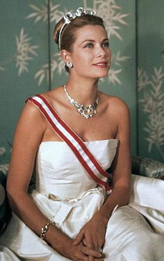 Her Serene Highness, Grace, Princess of Monaco wearing the Bains de Mer Tiara by Cartier. It includes three detachable brooches made of diamonds and cabochon rubies set in gold and platinum.