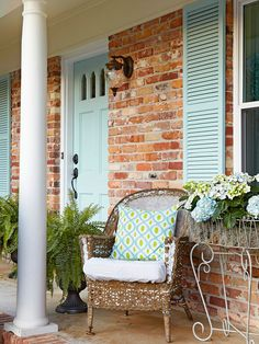 A pale blue door brightens this home's facade. More inexpensive ways to add curb appeal: http://www.bhg.com/home-improvement/exteriors/curb-appeal/curb-appeal-on-a-dime/?socsrc=bhgpin051513palebluedoor=2