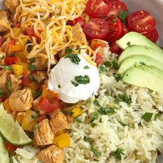 Chicken fajita burrito bowls are so easy to make at home! No need to go to restaurant for a burrito bowl anymore. Chicken, onion, peppers and seasonings cook in a skillet pan while cilantro lime rice simmers on the stove top. Serve with all your favorite Chicken Fajita Bowl, Chicken Fajitas, Fiesta Chicken, Quesadillas, Burritos, Enchiladas, Guacamole, Avocado, Cilantro Lime Rice