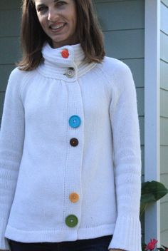 I actually have this sweater- I'm going to revamp it like she did but with different buttons