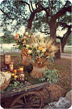 This would be lovely with sunflowers ~ love the rustic wagon and candles! Maybe navy ribbon around the flowers?