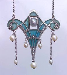 I'm not generally a huge fan of pearls, but these look so dainty dangling from that amazing necklace!