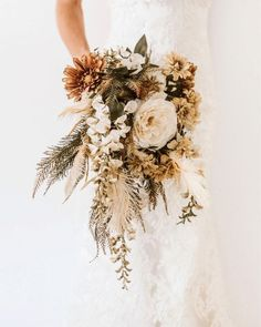 Wedding Bouquet Using silk flowers at your wedding? These are 10 tips you gotta know, and we are not so casually in love with the inspo ideas here too. Exhibit A? This cascading bouquet Bouquet En Cascade, Cascading Wedding Bouquets, Dried Flower Bouquet, Wedding Flower Arrangements, Bridal Flowers, Flower Bouquet Wedding, Floral Wedding, Silk Flower Bouquets, Silk Flowers For Wedding