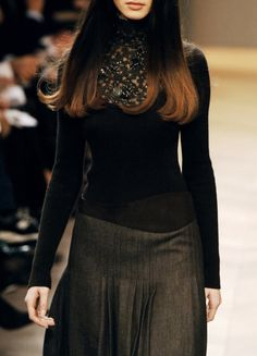 Sweater and pleated skirt